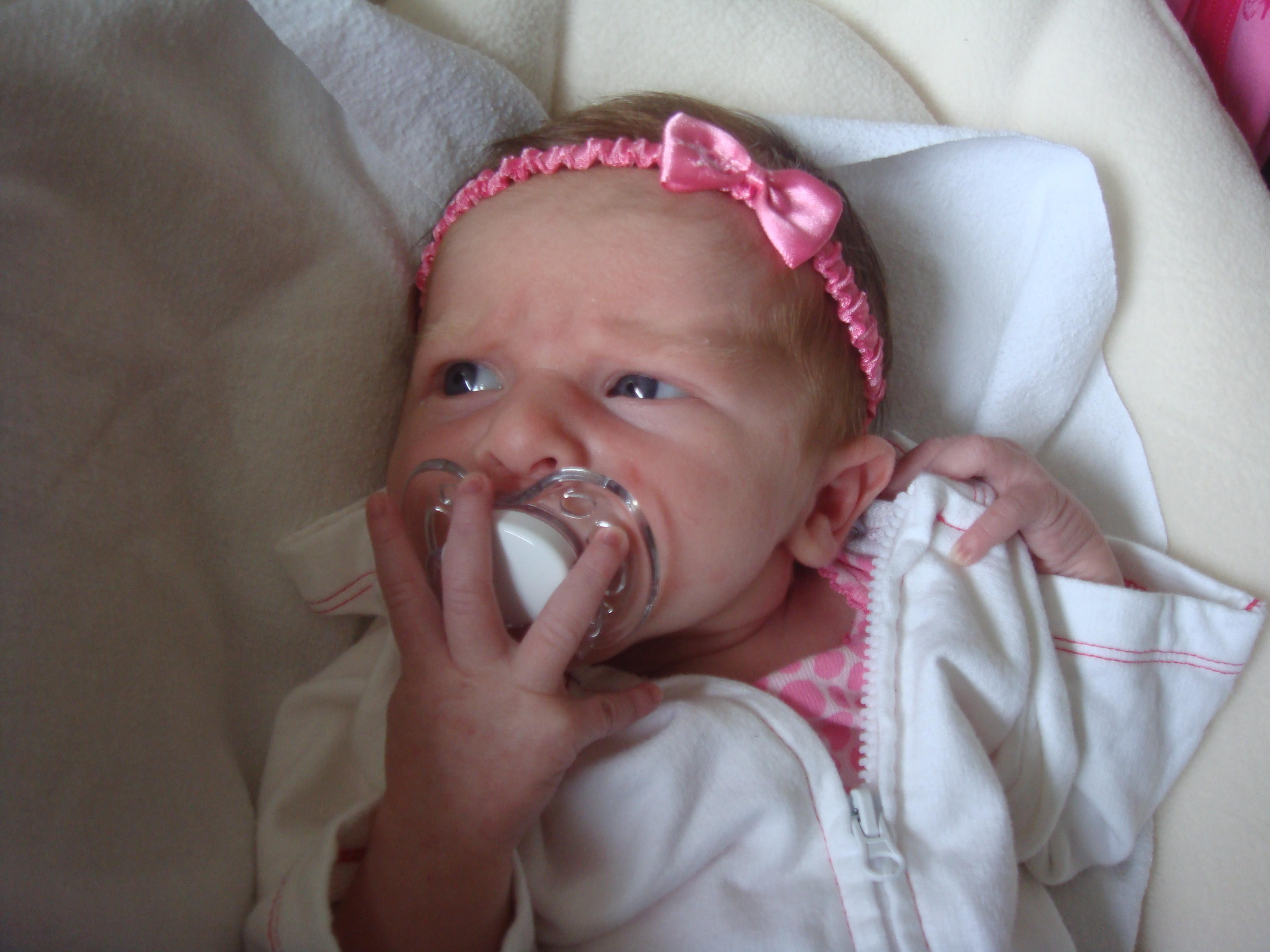 A few weeks old and in love with her paci