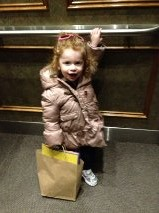 In the elevator to visit her great-grandparents!