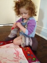 someone enjoys colouring in a PJ top and her winter boots!