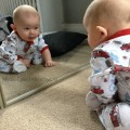 Little Dude loves looking at his reflection. It is so sweet watching him smile and coo at himself
