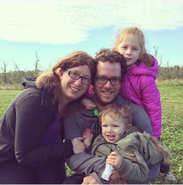 A family picture after a fun time apple picking