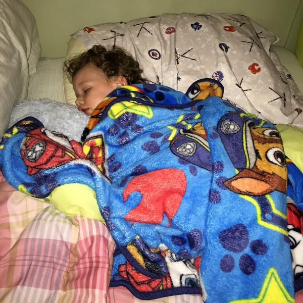 Little Dude slept in a big bed all by himself for the first time at the cottage